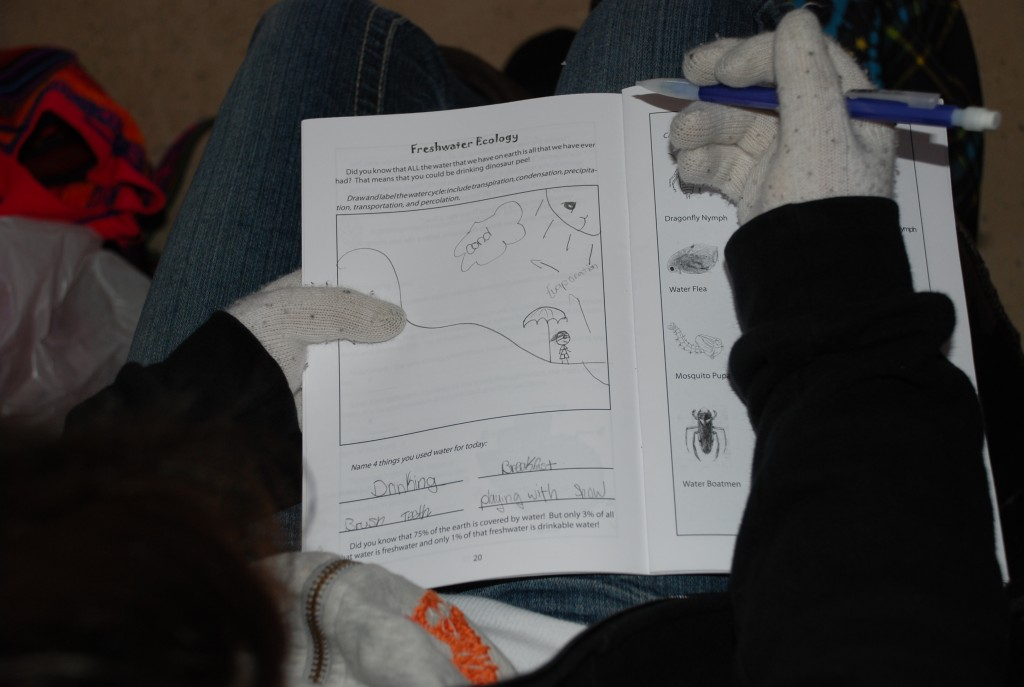 Here's a student filling out their science journal during freshwater ecology.