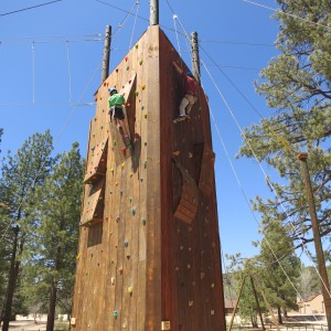 Climbers going up two of the three sides on our new climbing wall structure!